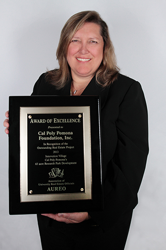 Sandra Acton holds the AUREO Award