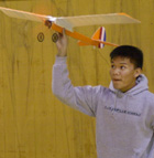 Kirk Bernal launches his team's radio controlled model airplane during testing in the Darlene May Gym. Bernal is a student in Dr. Don Edberg's Aero 101 class.