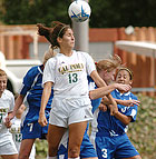 Stephanie Mrazik gets off a header in front of the Cal State Bakersfield goal during the Bronco's CCAA game.