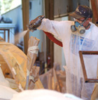 Mike Wiltshire sprays polyurethane foam on the Cal Poly rose float. The foam is donated by Resin Tech, a local company.