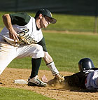 Cal Poly Pomona's Greg Johnston tags out Craig Yuhas of St. Martin's University as he attempts to steal second base.