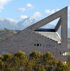 The CLA building at Cal Poly Pomona is framed by snowy mountains.
