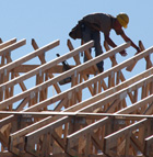 A carpenter works on the rafters of the new dormitories under construction at Cal Poly Pomona.