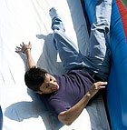 Daniel Bravo, a sophomore mechanical engineering major, tumbles down an inflatable slide during the ASI Outreach Tour at Cal Poly Pomona.