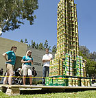 Students admire the Empire State Building made of canned foods by Theta Kapa Tau and Alpha Epsilon Lamda for the Greek Week can structure day competition.