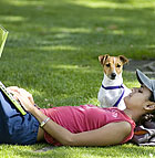 Jade Rivera, a animal science major, works on her laptop computer in the University Quad as her Jack Russell Terrier, Skittles, stands guard at Cal Poly Pomona.