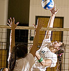 Brittany Harkey spikes a ball during a volleyball scrimmage against Regis University.