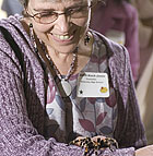 High School Counselor Judith Koch Jones watches a taratula crawl on her arm as she learns about the programs offered in plant science during Ag Counselor Day at Cal Poly Pomona.