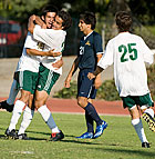 Eric Gonzalez hugs Aaron Borja after Borja  kicked the game winning goal in overtime during the Bronco's 2-1 win over Notre Dame de Namur.