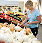 Shoppers search for Cal Poly Pomona grown produce at the Farm Store at Kellogg Ranch.