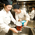 Adrianna Lee and Jenny Han drain tomatoes for their recipe during chili cook off for Collins School students at Cal Poly Pomona.