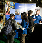 Students talk with recruiters from Lockheed Martin during the Hi-Tech job fair at Cal Poly Pomona.