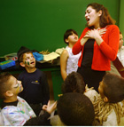 Catherine Galvan, a sophomore theater arts major, shows youngsters how to act as part of Shaking with Shakespeare, a collaboration between the Cal Poly Pomona Theatre Department and the Pomona Boys & Girls Club. Funded by a service-learning grant,  theatre students and children ages 5-12 put on scenes from Shakespeare at the Cal Poly Pomona Downtown Center.