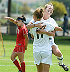 Cody McClure celebrates with Mary Carroll after she scored the first goal of the game during the Bronco's 2-1 win over Dixie State.