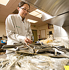 Christine Lam, a senior hospitality student, takes covering off a new oven as part of the renovation in progress at the kitchen of the Restaurant at Kellogg Ranch at Cal Poly Pomona.