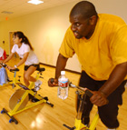 Students pedal their way to fitness during an Indoor Cycling class at the Bronco Fitness Center.