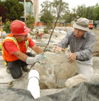Architect Takeo Uesugi shows Manuel Marquez how he wants a boulder positioned as the Japanese Garden takes shape at Cal Poly Pomona.