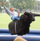 Basketball player Marisa Lattin rides a mechanical bull during  the Celebration of Excellence in Academics and Athletics gala. The Athletics department  honored its student-athletes during an old-fashioned country barbeque Thursday, June 5, 2003 near Kellogg Gym.