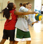 Cal Poly Pomona basketball player Marisa Lattin pulls down a rebound from Arian Johnson during a drill at Girls' Basketball Camp.