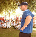 Anaheim Angels outfielder Darin Erstad talks with youngsters at the Cal Poly Pomona baseball camp. Erstad signed autographs and posed for pictures during his visit.
