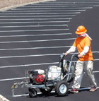 Antonio Vargas paints parking lot stripes on a freshly resurfaced Parking Lot J  near the College of Environmental Design.
