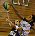 Colin Lockett, 11, tries to get a shot off around Malcolm Green, 12,  at basketball camp in the Kellogg Gym at Cal Poly Pomona.