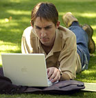 Kevin Marshall, a senior business major, works on his laptop on a sunny day at Cal Poly Pomona.