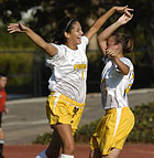 Stephanie Mrazik celebrates her goal with Laura Dobbins during a CCAA soccer match against Cal State Monterey Bay. The Broncos went on to win 6-0.