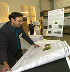 Sowmya Mitra lays out posters for his research on turf grass irrigation during the Agricultural Research Initiative Showcase at Cal Poly Pomona.