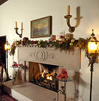 A fire burns in the fireplace at Kellogg House Pomona, decorated for the holidays.