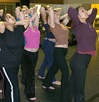 Members of a Modern Dance 1-2 class move as a group during a session incorporating new technology.