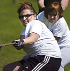 From left, Christina Leonard, Erin Shapiro and Adrienne Lawrence practice their tug l of war technique as the Kappa Delta Sorority girls get ready for the Greek Olympics later in the year.