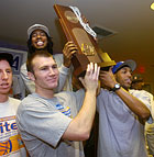 From right, Jeff Bonds, Hervey Malone III, David Sabesma and Matt Nelsen hold up the NCAA West Region championship trophy during a post season celebration for the men's and women's basketball teams.