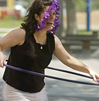 Ann-Marie Ontiveros tries the hula hoop during the Academic Affairs barbeque.