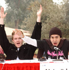 The Alpha Psi Omega team of Aaron Thomas, Justin Abarca and Marco Tello celebrate their win over the Golden Key team in the Wellness Challenge during the Wellness Fair 2002 in the University Quad. The competition pitted student groups against each other in a test of general health knowledge.