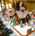 The kitchen staff at Kellogg West Gingerbread Village adorns the KW lobby at Cal Poly Pomona.