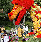 "The 2006 Cal Poly Universities Rose Float entry, ""Enchanted Reverie,"" is surrounded by students looking for flower souvenirs as the float was put on display on campus following its appearance in the Tournament of Roses Parade Jan. 2."