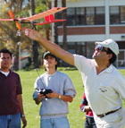 Dr. Don Edberg launches a student piloted radio controlled plane. Students built and flew the  electric powered airplane as part of their Aero 101 class.