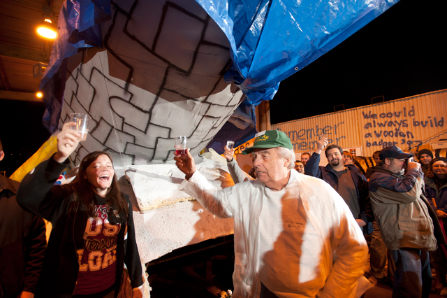 """Ron Simons leads a toast as 2011 rose float, """"Galactic Expedition,"""" begins its journey to Pasadena on December 19, 2010."""