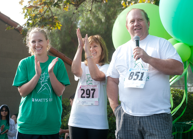 Jenna, Chris and Kevin Myers present awards during the Matthew Myers Memorial 5K on October 15, 2011.