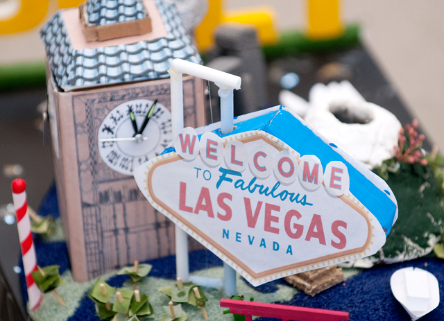"""The """"Adventure is Out There"""" mini rose float features a Las Vegas sign and Big Ben."""