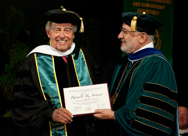 Ron Simons receives an honorary doctorate at the College of Agriculture commencement ceremony on June 10, 2012.