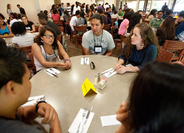 Summer Bridge students talk with Upward Bound students at a mixer July 17, 2012.