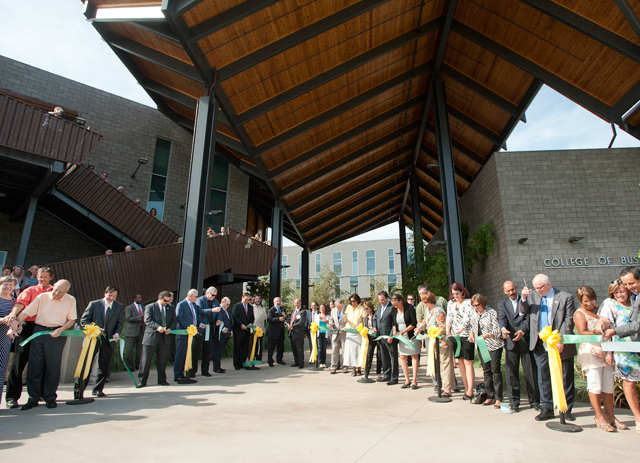 Administrators, donors and alumni take part in the ribbon cutting of the new College of Business Administration complex September 21, 2012.