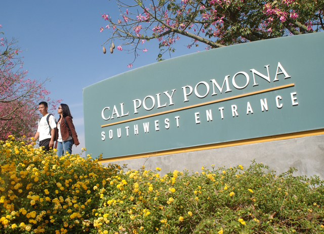 Thumbnail image for Students walk past the Cal Poly Pomona entrance sign.