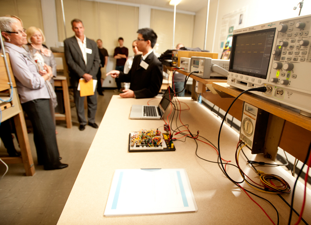 Engineering student Vincent Nhieu demonstrates equipment during dedication of the Colombatto Family Laboratory February 10, 2012.