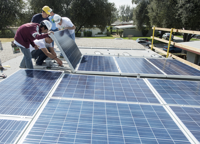 GRID Team Installs Solar Panels for Community
