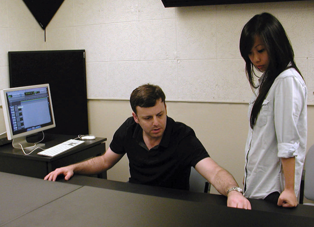 Music Professor Arthur Winer works in the music recording studio.