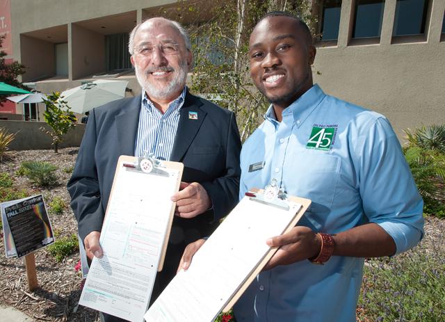 President Michael Ortiz and ASI President Chris Osuala man a voter registration table on September 25, 2012.