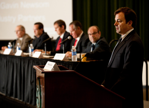 Michael Kelly, executive director of the Los Angeles Coalition for the Economy and Jobs, moderates the panel discussion during the Aerospace and Cyber Security Workforce Development Summit on October 9, 2012.